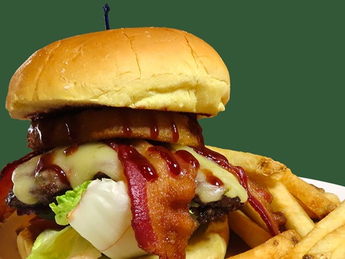 Photo of Western Bacon Barbecue Burger served with fries