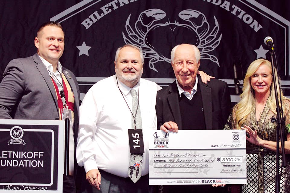 Co-founder Oli DeRuyter and one of it's lead officers Keith Smith present a cheque for $5000.25 to the Biletnikoff Foundation at the 2019 Crab Fest