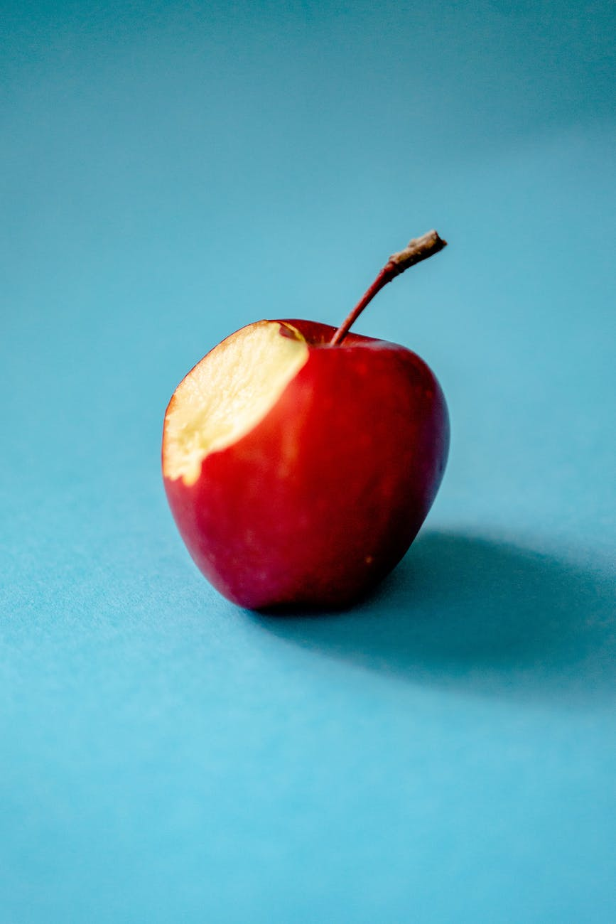 red apple on blue background