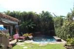 The side yard, to the right mom and dad have some veggies planted and straight ahead, of course, the saltwater pool