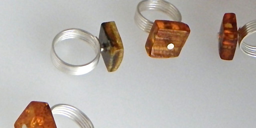 160 - Free Form Square Amber Rings