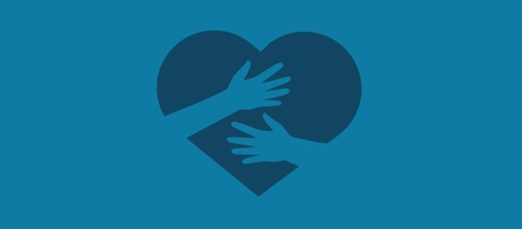 Hands holding heart graphic.