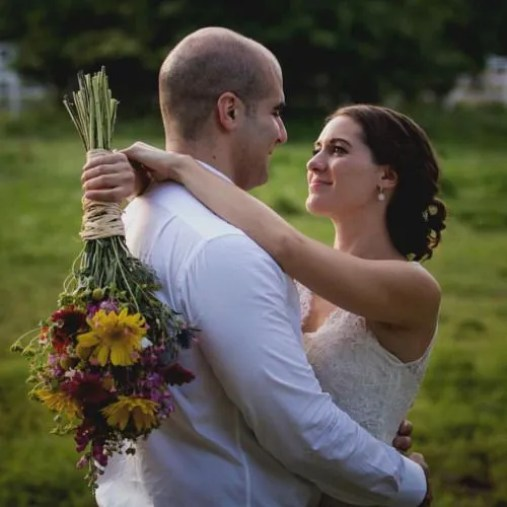couple with yellow and red bridal bouquet
