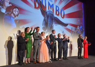 """LONDON, ENGLAND - MARCH 21: (L-R) Danny Devito, Eva Green, Collin Farrell, Nico Parker, Finley Hobbins, Justin Springer, Katterli Frauenfelder, Derek Frey, Tim Burton and Edith Bowman on stage at the European Premiere of Disney's """"Dumbo"""" at The Curzon Mayfair on March 21, 2019 in London, England. (Photo by Gareth Cattermole/Getty Images for Disney)"""