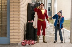"""SHAZAM! Copyright: © 2019 WARNER BROS. ENTERTAINMENT INC. Photo Credit: Steve Wilkie/ & © DC Comics Caption: (L-r) ZACHARY LEVI as Shazam and JACK DYLAN GRAZER as Freddy Freeman in New Line Cinema's action adventure """"SHAZAM!,"""" a Warner Bros. Pictures release."""