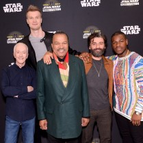 """CHICAGO, IL - APRIL 12: (EDITORS NOTE: Retransmission with alternate crop.) (L-R) Anthony Daniels (C-3PO), Joonas Suotamo (Chewbacca), Billy Dee Williams (Lando Calrissian), Oscar Isaac (Poe Dameron) and John Boyega (Finn) attend """"The Rise of Skywalker"""" panel at the Star Wars Celebration at McCormick Place Convention Center on April 12, 2019 in Chicago, Illinois. (Photo by Daniel Boczarski/Getty Images for Disney ) *** Local Caption *** Anthony Daniels; Billy Dee Williams; Oscar Isaac; John Boyega; Joonas Suotamo"""