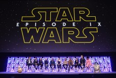 """CHICAGO, IL - APRIL 12: (L-R) BB-8, Moderator Stephen Colbert, Director J.J. Abrams, Producer Kathleen Kennedy, Anthony Daniels (C-3PO), Billy Dee Williams (Lando Calrissian), Daisy Ridley (Rey), John Boyega (Finn), Oscar Isaac (Poe Dameron), Kelly Marie Tran (Rose Tico), Joonas Suotamo (Chewbacca), Naomi Ackie (Jannah) and R2-D2 onstage during """"The Rise of Skywalker"""" panel at the Star Wars Celebration at McCormick Place Convention Center on April 12, 2019 in Chicago, Illinois. (Photo by Daniel Boczarski/Getty Images for Disney ) *** Local Caption *** Stephen Colbert; J.J. Abrams; Kathleen Kennedy; Anthony Daniels; Billy Dee Williams; Daisy Ridley; John Boyega; Oscar Isaac; Kelly Marie Tran; Joonas Suotamo; Naomi Ackie; BB-8; R2-D2"""