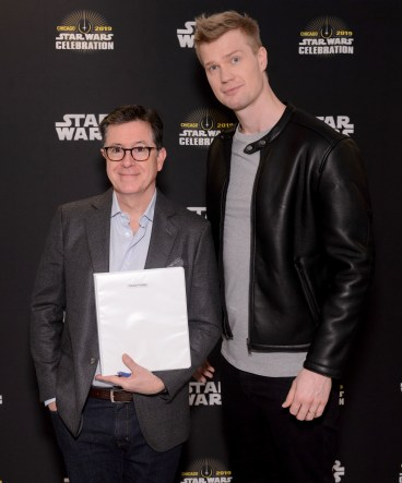 """CHICAGO, IL - APRIL 12: Stephen Colbert (L) and Joonas Suotamo (Chewbacca) attend """"The Rise of Skywalker"""" panel at the Star Wars Celebration at McCormick Place Convention Center on April 12, 2019 in Chicago, Illinois. (Photo by Daniel Boczarski/Getty Images for Disney ) *** Local Caption *** Joonas Suotamo; Stephen Colbert"""