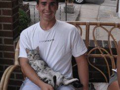 OP-Beaurier-Jun-22-2009-American-Shorthair-silver-tabby-kitten-lying-on-back-relaxing-in-mans-arm