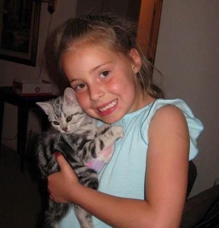OP-Fia-Zephyr-Jun-6-2011-girl-in-blue-shirt-holding-American-Shorthair-silver-tabby-kitten
