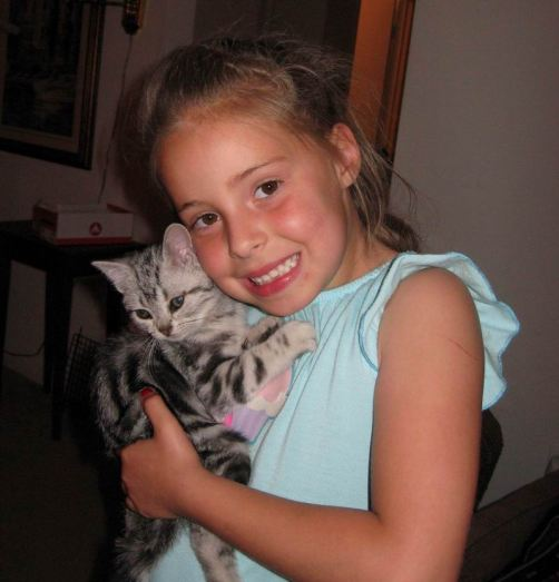 OP-Fia-Zephyr-Jun-6-2011-girl-in-blue-shirt-holding-American-Shorthair-silver-tabby-kitten