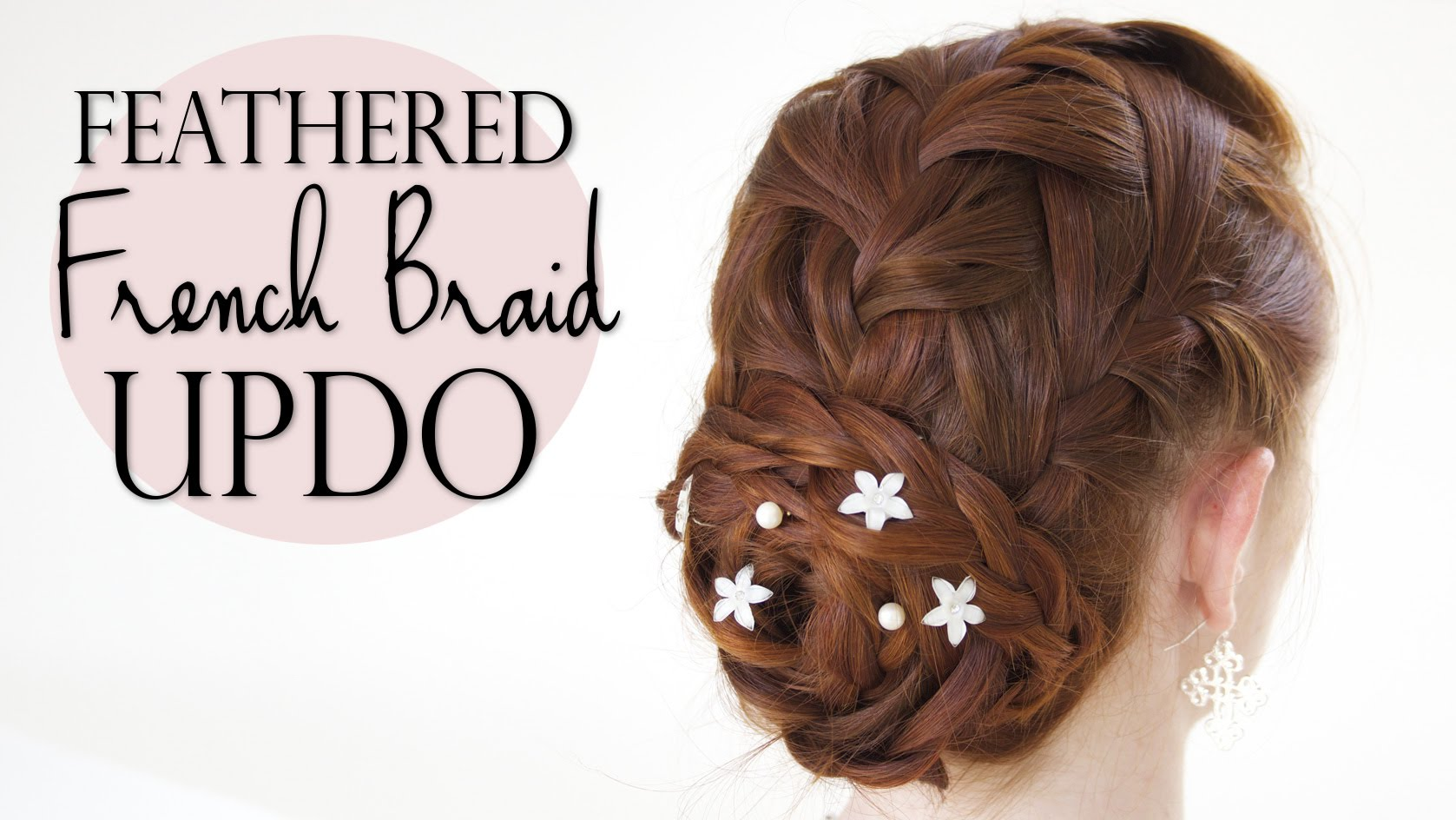 Elegant Feathered French Braid Updo