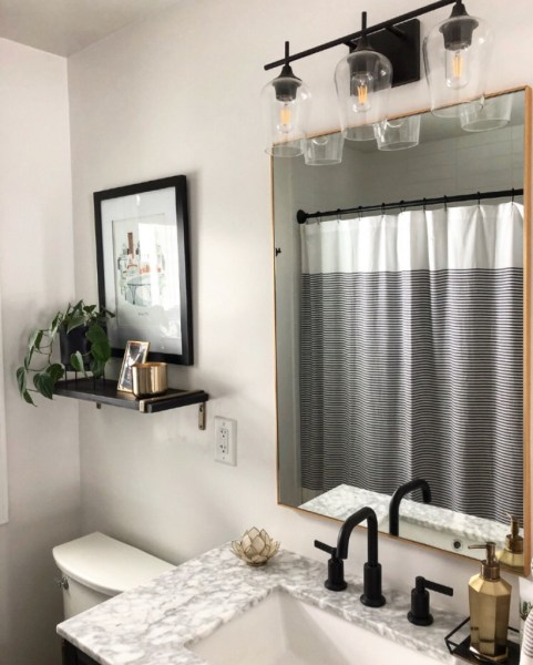 Sima Spaces modern black and gold bathroom