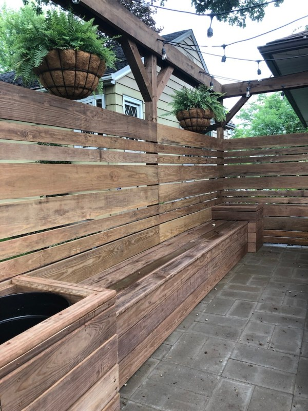 Sima Spaces Built in bench, planters, pergola, and privacy fence using pre-treated cedar-toned lumber