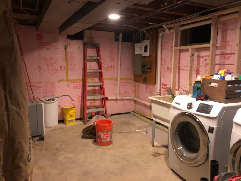 basement laundry room, mid-renovation: Sima Spaces Spring ORC 2020