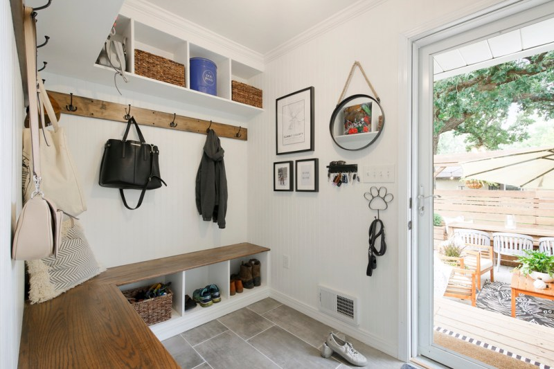 Modern Mudroom with white and wood builtin cubbies and benches, modern farmhouse, modern rustic mudroom / Sima Spaces