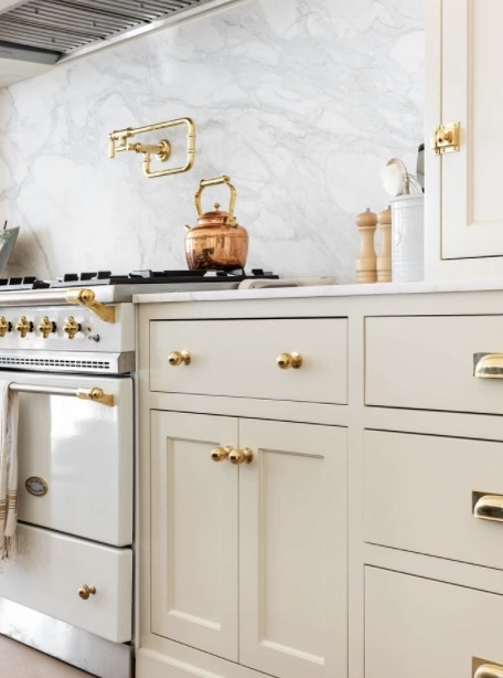 Beautiful inset mushroom colored cabinetry with brass hardware via Studio McGee // Sima Spaces kitchen remodel