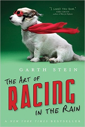 "Cover for ""The Art of Racing in the Rain"" featuring a  white dog with red racing goggles and a red scarf on a green background."