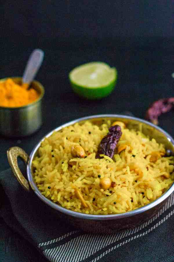 Got leftover rice? Turn it into Lemon rice - a popular and flavorful South Indian dish that you can make in less than 15 minutes. An easy lunch box option that you can put together the night before or in the morning without any fuss.