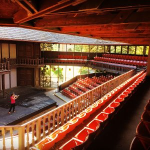 A student practices violin at Southern Utah University's Adams Shakespearean Theatre.