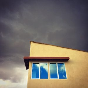 Angled roof beneath angry clouds in the community of Civano.