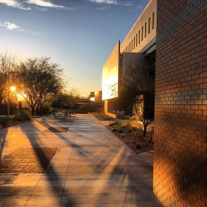 Sunset on the south edge of McClelland Hall on the University of Arizona campus.