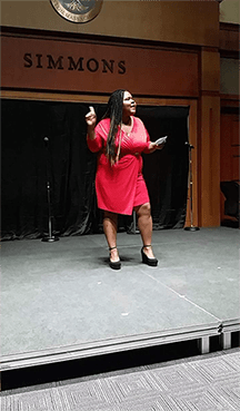 A student in red delivers her monologue