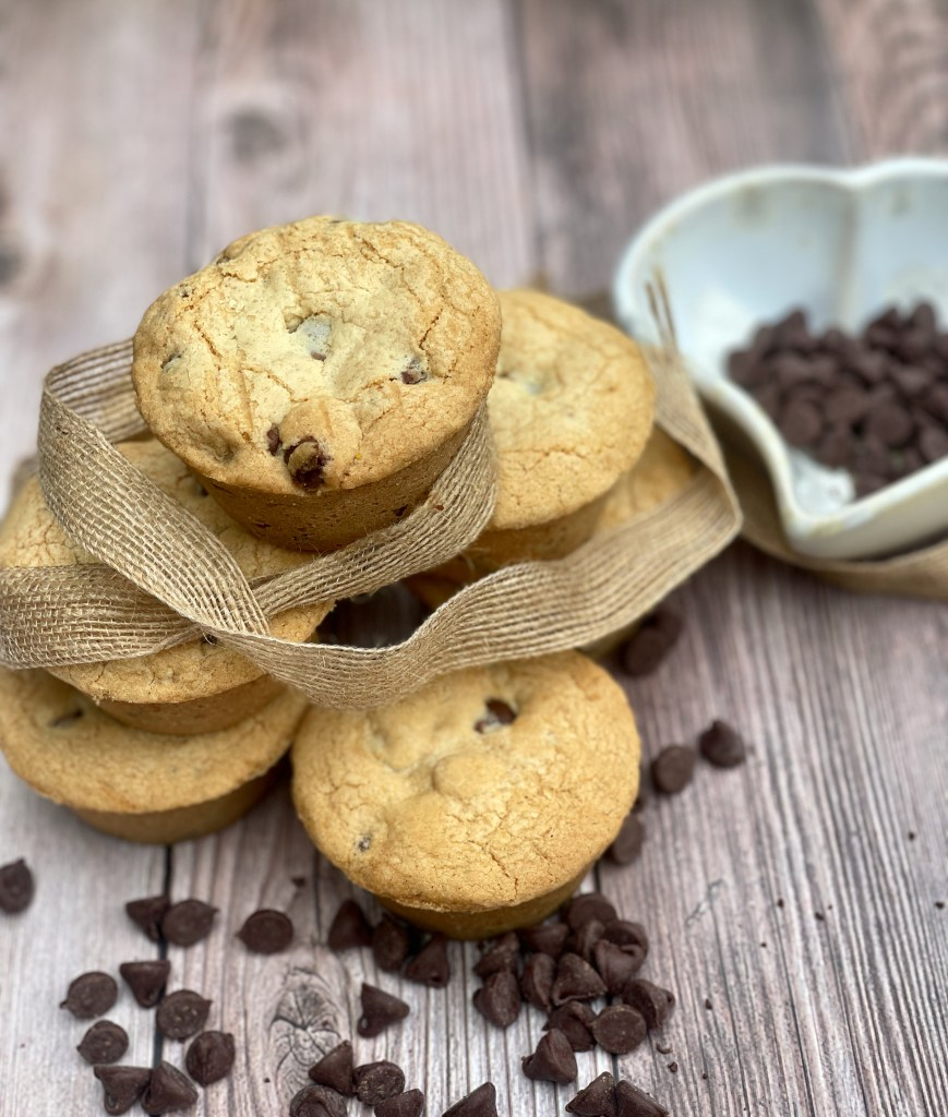 Stack of fragrant gluten-free Chocolate Chip Lava Cookies, with lose chocolate chips