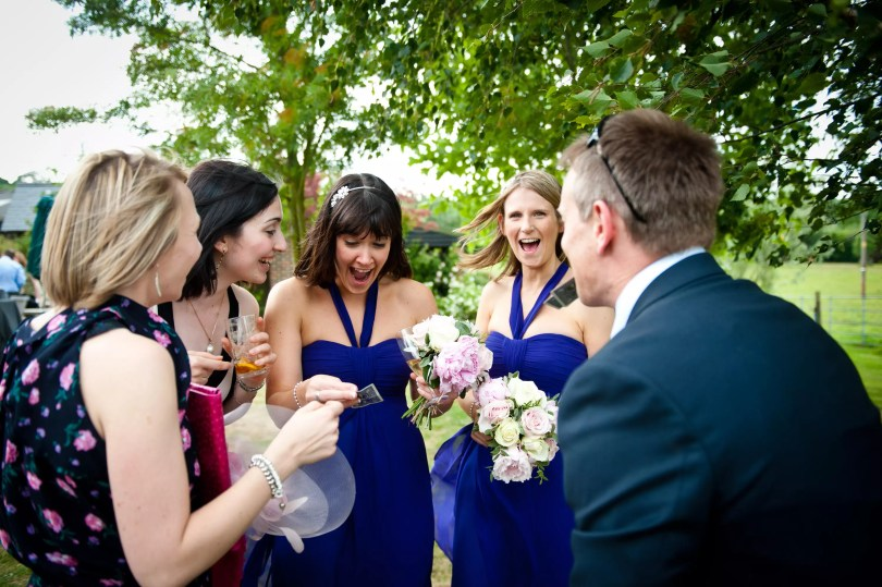 Wedding Magician performs to screaming bridesmaids