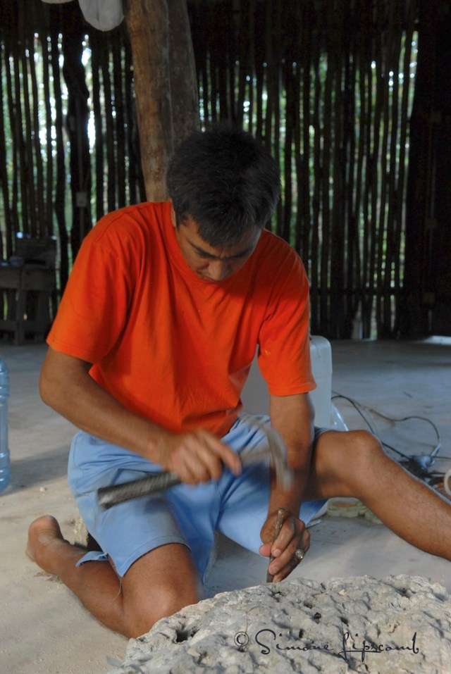 Armondo carves stones that he places on his property in Akumal, Mexico as a way to honor the earth