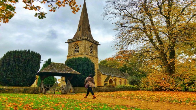 Walking in Churchyard, Lower Slaughter, The Cotswolds
