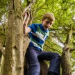 Ricoh GXR S10 lens - Small boy climbing a tree