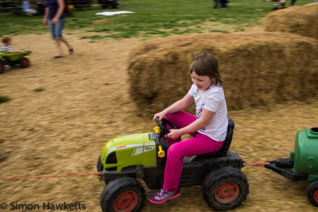 Wimpole Hall in Cambridgeshire pictures - Emma on a tractor