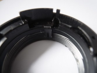 Pentacon 50mm strip down and clean - The lever with the focus ring in place