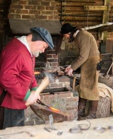 The blacksmith in the forge at Kentwell hall in Suffolk