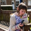 Pictures of Framlingham in Suffolk - A girl sitting on a bench with a camera