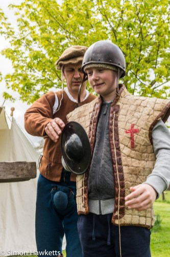 Kentwell Hall Tudor day pictures - Small boy fitted with armour
