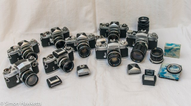 A picture of a collection of Miranda 35mm cameras, viewfinders and lenses