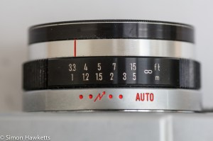 Mamiya 135 EE 35mm rangefinder camera showing the focus and auto exposure settings