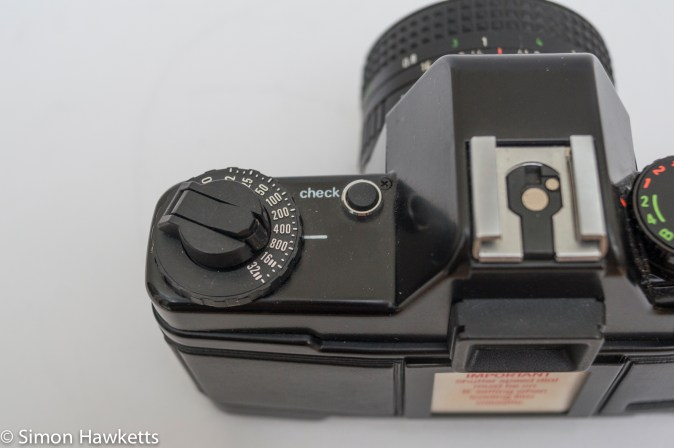 Praktica BMS 35mm SLR showing film speed setting and battery check button