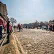 A cobbled street and a full sun by the Ouse in York
