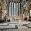 Sony Nex 6 pictures - A girl walks over a tiled floor in York Minster