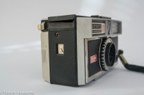 Kodak Instamatic 300 126 film camera showing rear door release and film advance