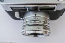 Voigtlander Dynamatic II 35mm rangefinder camera showing auto setting on lens and shutter speeds