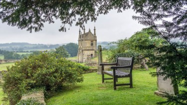 A seat in the graveyard next to the East Banqueting house in Chipping Campden