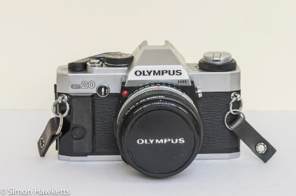 Olympus OM-20 35mm SLR - Front view with lens cap on