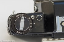 Detail shot of Praktica B200 film speed dial, exposure compensation and exposure lock button