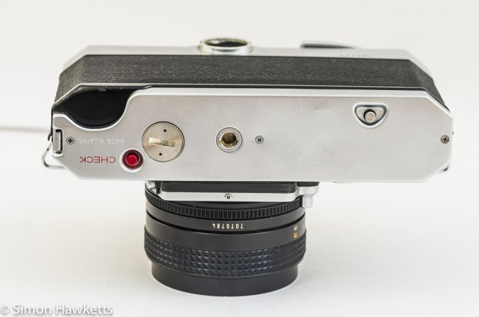 Konica Autoreflex T2 35mm slr bottom view showing battery compartment and check button