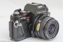 Pentax Program A 35mm slr side view showing self timer, depth of field preview and lens release