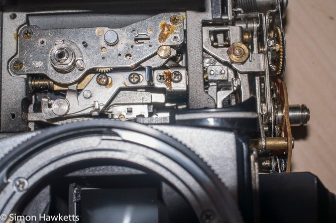 Petri FTII front plate removed showing self timer mechanism and shutter release rod